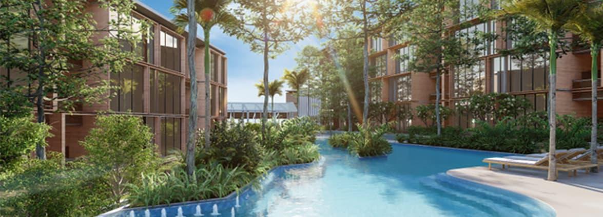 Condominium avec piscine et vue sur la mer. Végétation luxuriante.